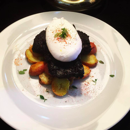 Poached Eggs with Seared Boudin Noir & over roasted baby potatoes.