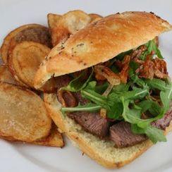 Horseradish Crusted Steak Sandwich with Arugula and Crispy Shallots