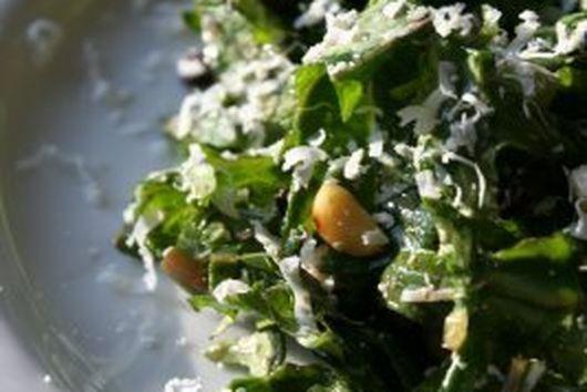Raw Kale Salad with Pinenuts, Currants, and Ricotta Salata