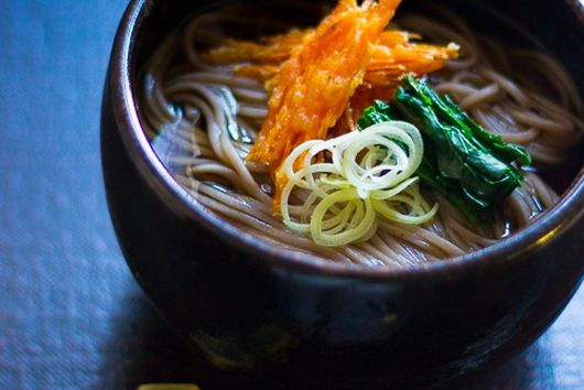 Soba noodle soup with carrot tempura, arugula and leek