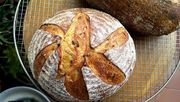 8d21631c-9f49-4e42-89ae-02191bea081e--saffron_and_truffle_sd_bread_with_sunflower_seeds_boule_top_view
