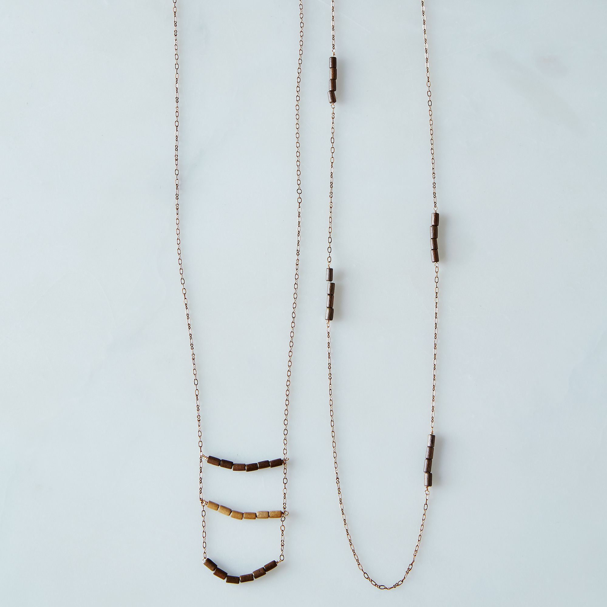 F8390c2e a0f7 11e5 a190 0ef7535729df  2015 0311 brass and wood necklace set of 2 walnut stained silo 065