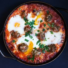 Braised Green Chorizo Meatballs and Eggs in a Harissa Tomato Sauce