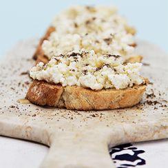Crostini with ricotta, truffle honey and smoked salts