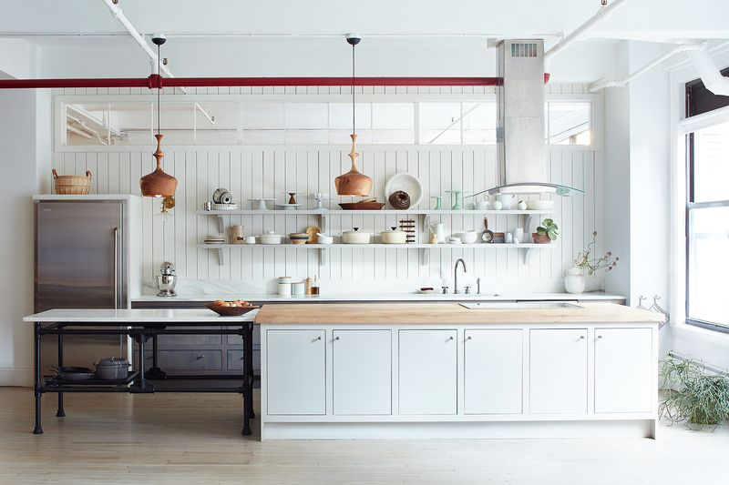 Our test kitchen's pendant lamps that Claudia loved, and the open shelves that inspired her design.