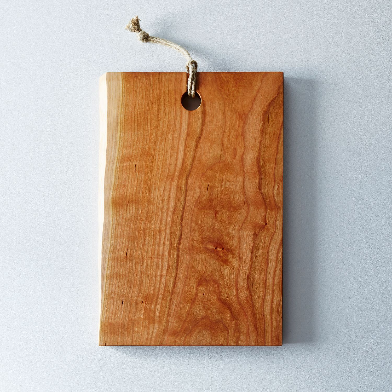 Wood Edged Board ~ Live edge domestic wood serving cutting board on food