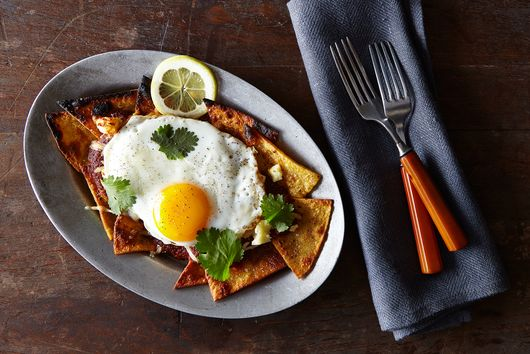 A Pile of Good, Better, and Best, Topped with a Fried Egg