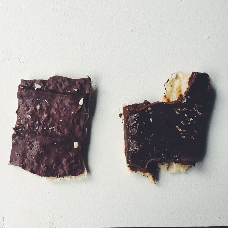 Two editors, two pieces of chocolate-covered affliction bread.