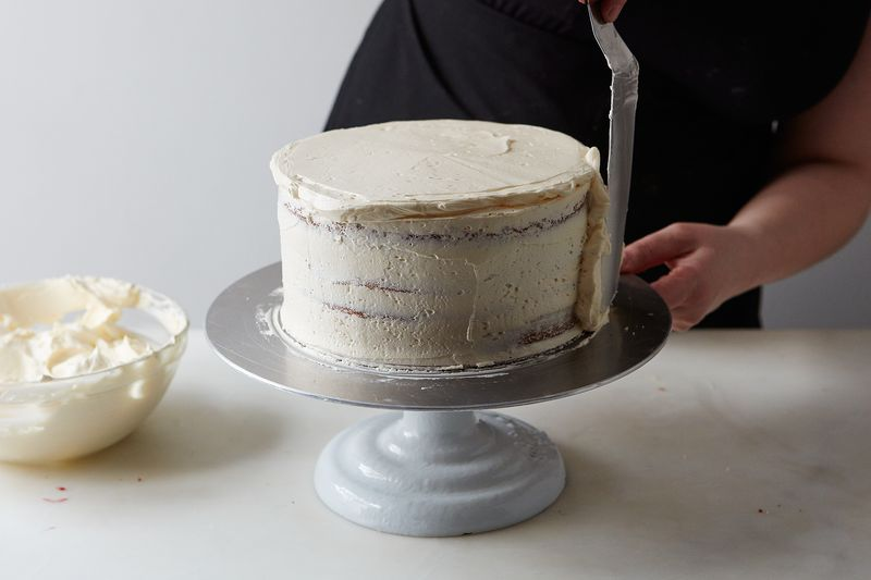 A thin crumb coat makes it easier to apply a smooth, crumbless layer of frosting later.