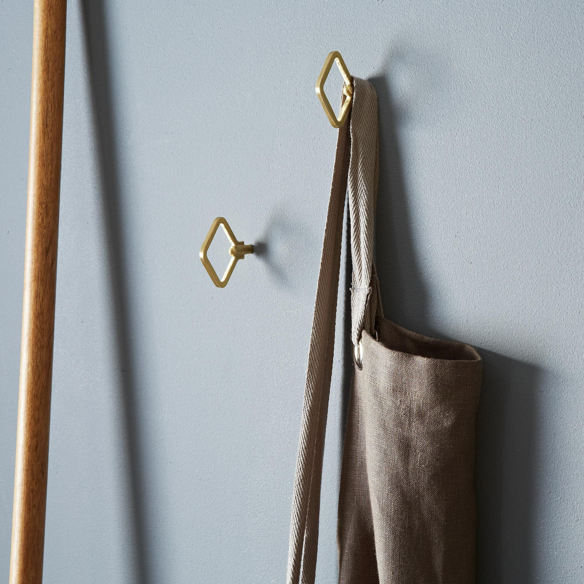 diamond shaped brass wall hooks on food52
