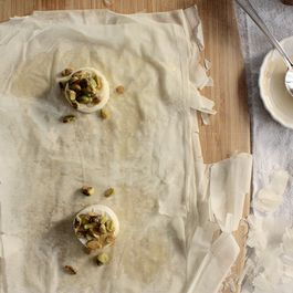 Mini phyllo wrapped brie with honey and pistachios