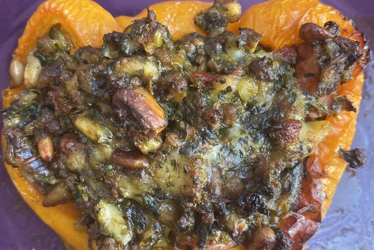 Stuffed peppers with lamb, nuts and greens