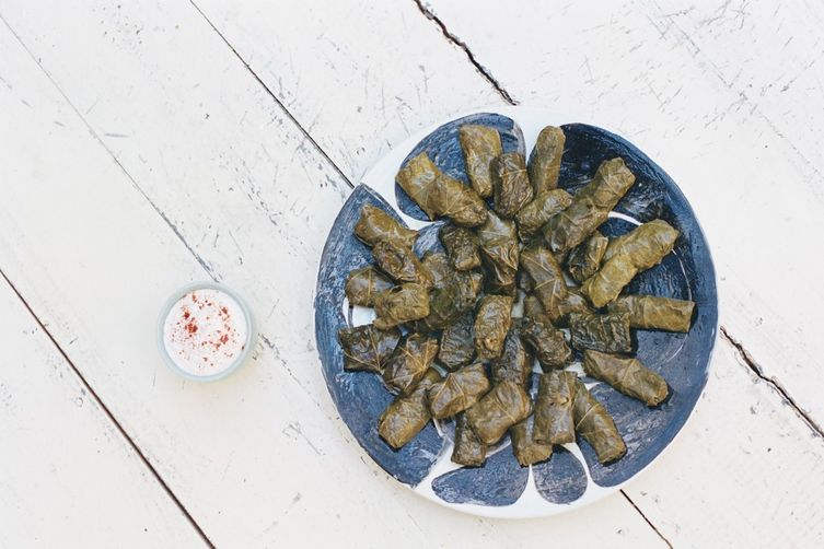Stuffed grape leaves with lentils, oregano and mint