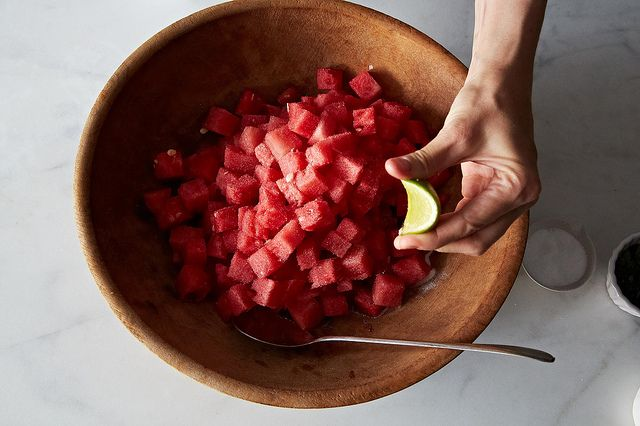 Season the watermelon and tomatoes with lime and salt