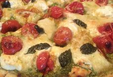 PESTO PIZZA WITH ROASTED TOMATOES, HOMEMADE RICOTTA, AND CARAMELIZED ONIONS
