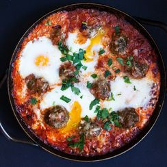 Braised Green Chorizo Meatballs and Eggs in a Harissa Tomato Sauce