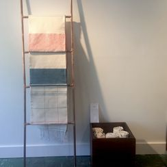 A DIY Display Ladder From Rosy Copper Pipes