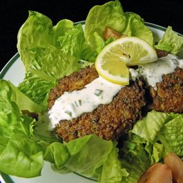 Oven Baked Crab Cakes With Lemon Aioli Served Over Salad