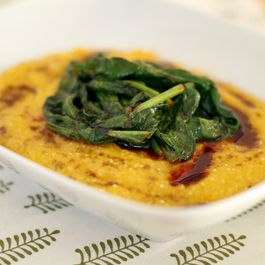 Creamy butternut squash polenta with spicy wilted spinach
