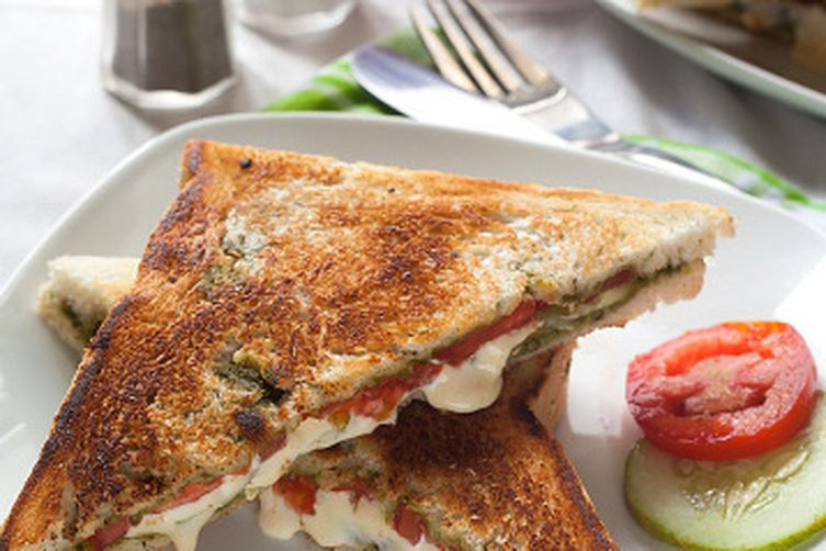 Grilled vegetable cheese sandwich with spinach avocado spread: