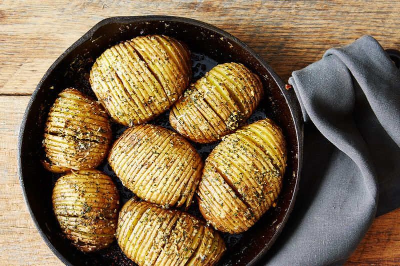 """Please cover me in cream and cheese!"" —Hasselback potatoes"