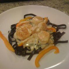 Shrimp and Scallops in Saffron Cream with Black Pasta