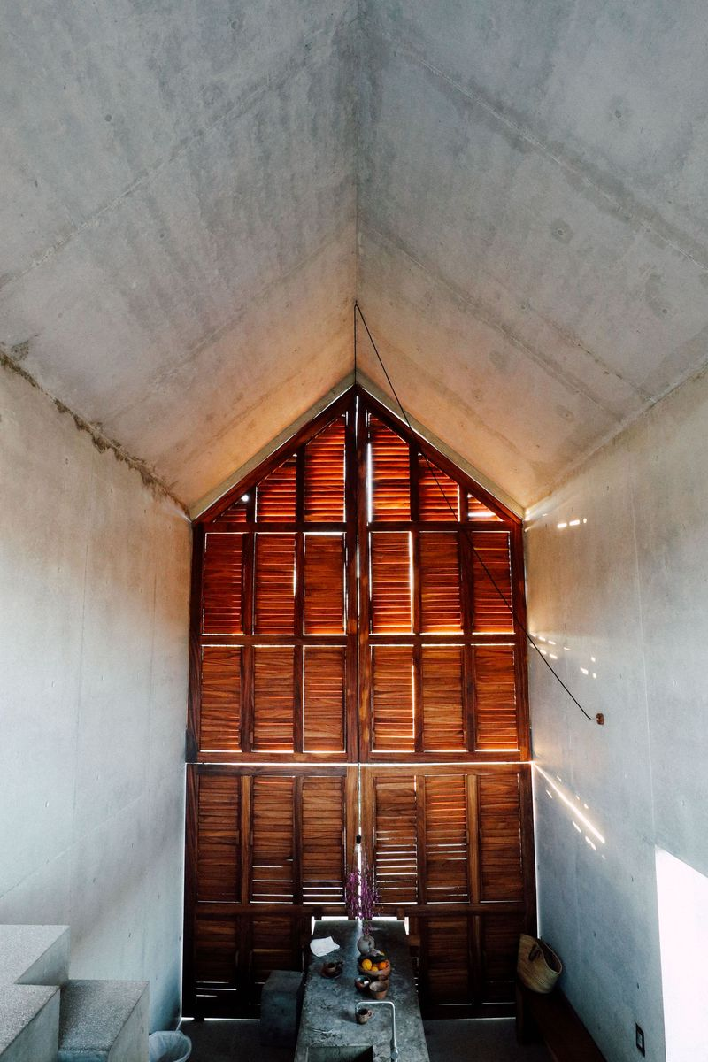 A wall of shutter-style panels lets beams of light filter inside when the doors are closed.