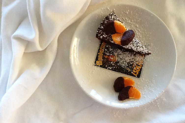 flourless chocolate cake with chocolate-dipped orange segments & sea salt