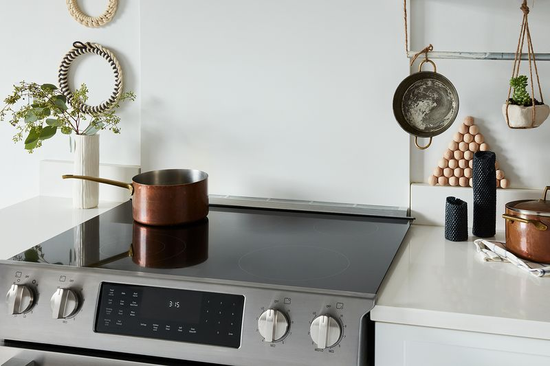 Cozy up the area around your stovetop (like this Bosch electric range) with DIYs aplenty.
