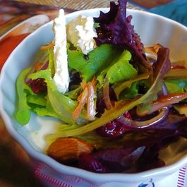 Smoked Salmon Salad with Cayenne Almonds, Dried Cranberries, and Goat Cheese.