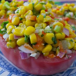 BEEF STEAK TOMATOES STUFFED WITH CORN AND HERB SALAD