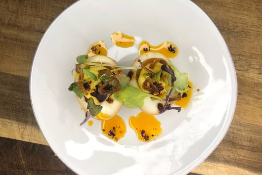 Soy Mirin Deviled Egg with Crispy Shallots, Chili Oil and Microgreens