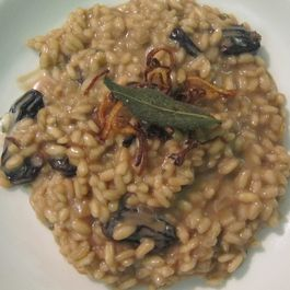 Balsamic Risotto with Prima Black Raisins, Crispy Shallots and Sage