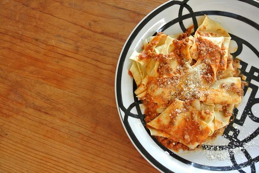 rustic hand-cut pappardelle with ragu' bolognese