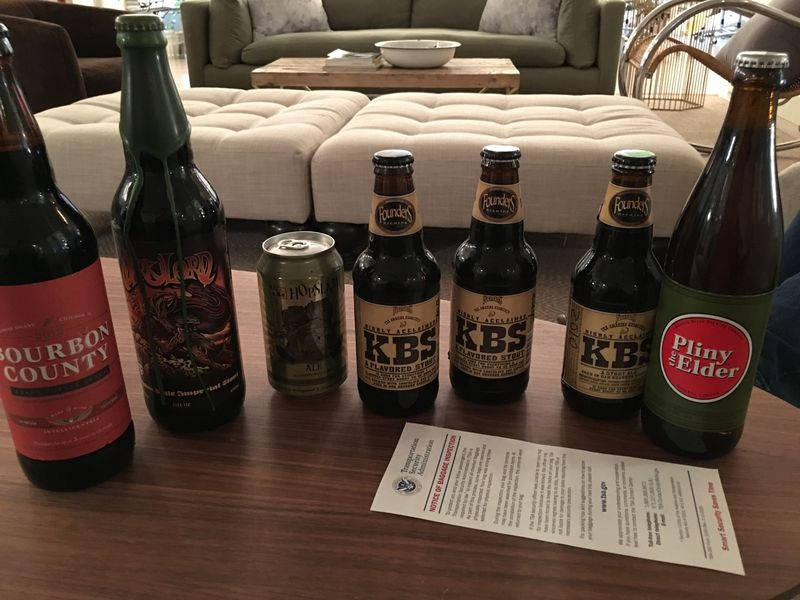 From left to right: Goose Island Bourbon County, Dark Lord, Bells Hopslam, Founders Kentucky Breakfast Stout, Pliny the Elder and a friendly TSA note. Not pictured: Bells Batch 7000 (who was evidently sick on yearbook day.)