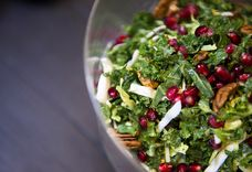 SuperGreens Salad with Pomegranate, Walnuts, and Hummus Dressing