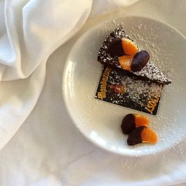 flourless chocolate cake with chocolate-dipped orange segments & sea salt