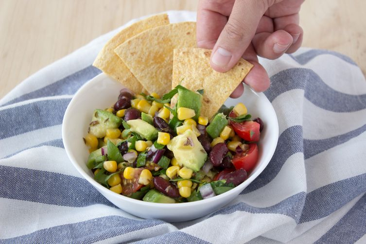 Black bean, corn and avocado salad with tortilla chips