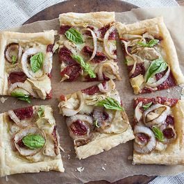 81903ba1-f458-4e57-8c3c-5559b0602176--sun_dried_tomato_and_goat_cheese_brie_tart_011412_0050