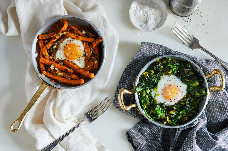 Eggs cooked on sweet potato fries; eggs cooked on spinach...