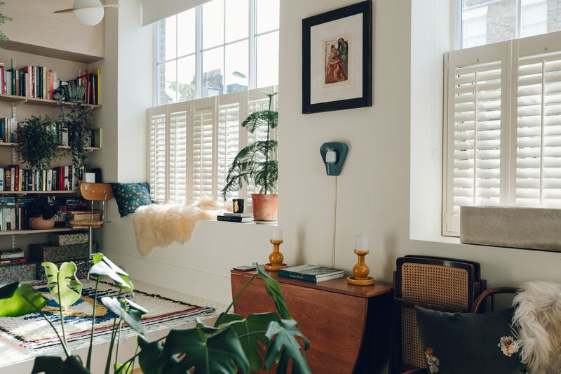 Shutters allow the light to flutter in (and lend privacy, as the apartment's at street-level).