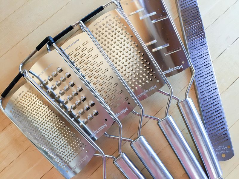 "Jenya's extensive, beloved set of graters. ""I use them every day to grate everything from garlic, onions, zest, cheese and chocolate,"" she says."