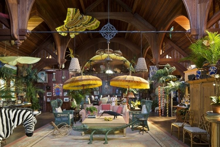 Part of a converted church, this living room boasts a menagerie of whimsical objects, including a twelve foot-wide butterfly kite suspended from the ceiling.