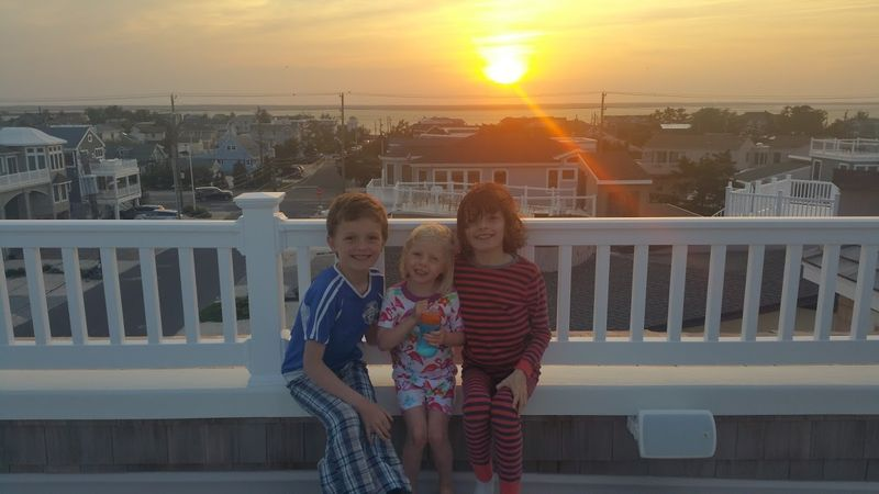 A Food52 founders' kid sandwich: Merrill's oldest, flanked by Amanda's twins, posing for a picture on LBI.