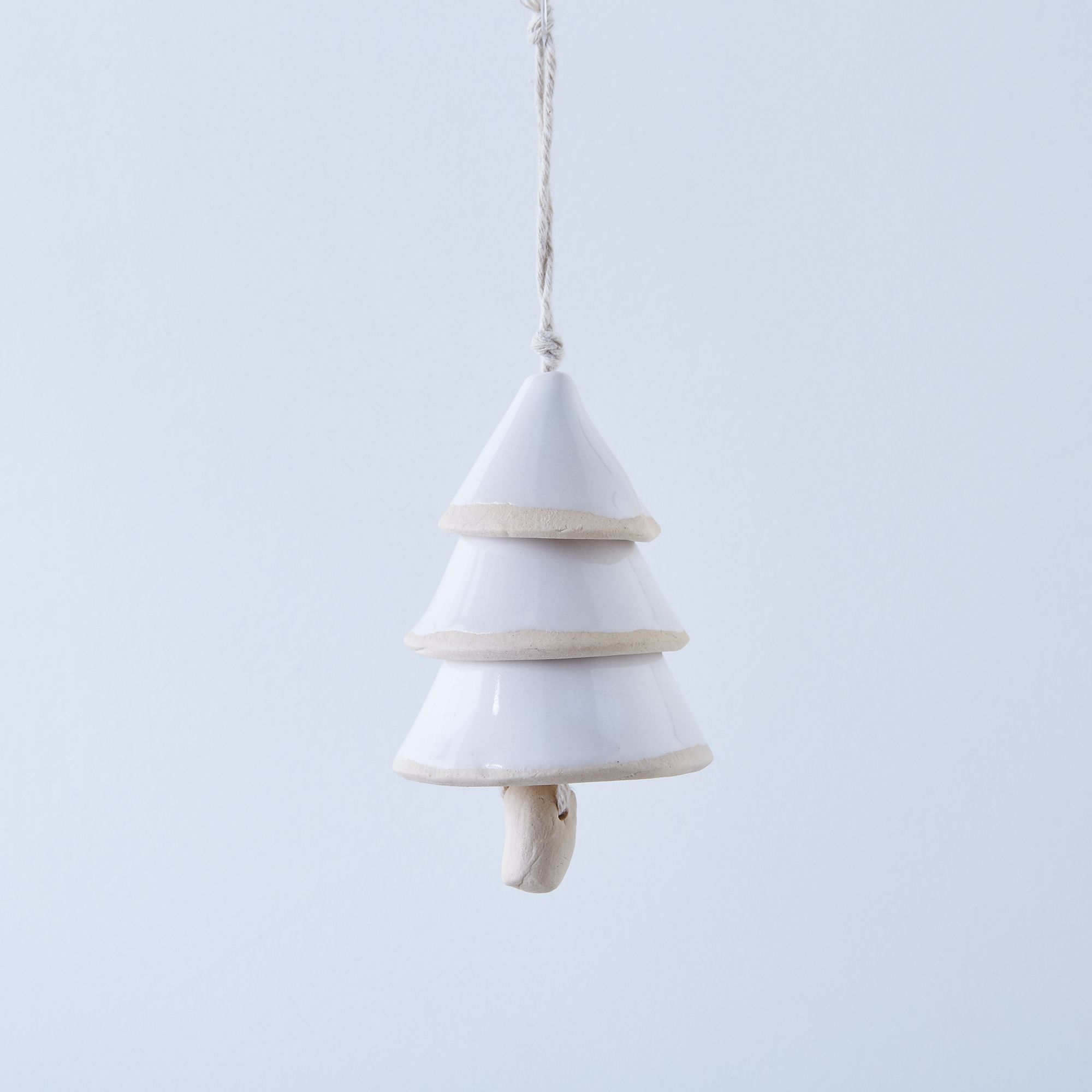 34d2f925 60aa 4c79 be8d ee7785f46227  2016 1004 handmade studio tn ceramic tree bell ornament white silo rocky luten 0628