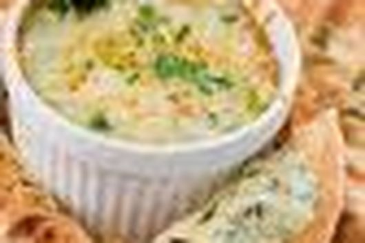 Hot and Cheesy Corn and Artichoke Dip