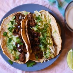 Chile Braised Pork Tacos with Avocado Tomatillo Salsa