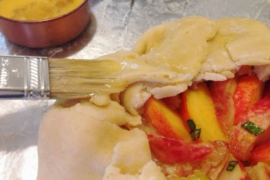 basil-cardamom peach galette with mashed raspberry whipped cream
