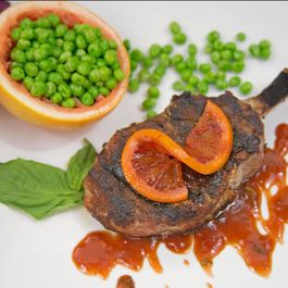 Grilled Pork Chops with Blood Orange Sauce & Butter-Sauteed Peas