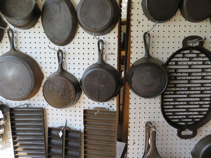 A bunch of lovely vintage cast iron at a flea market.